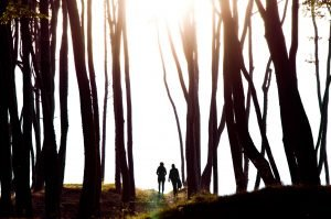 Two person in the forest.